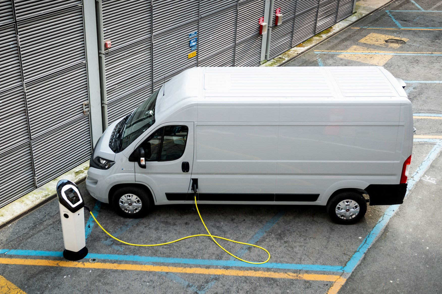 Fiat E-Ducato review - plugged in to charge, high view, white
