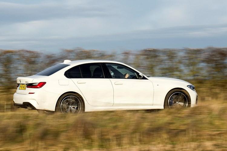 BMW 330e (2021) rear view, driving
